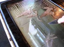 cleaning oven door glass without