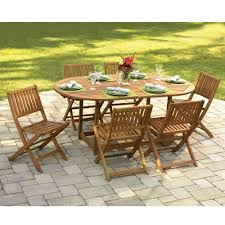 the eg patio table and stowable chairs hammacher schlemmer the tabletop leaves fold down and the folding chairs stack neatly between the table legs