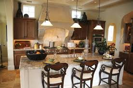 An Elegant Eat In Kitchen Of Modest Size, Featuring A Large Granite Island  With