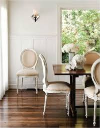 dinning room bright white walls cream colored chairs dining room table stained to match the color of stain on the floor my dining room inspiration