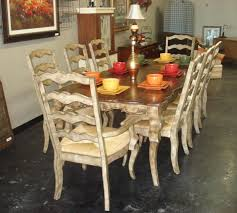 classic french country style dining room sets with 8 white ladder chairs and old wooden dining table for small dining room spaces ideas