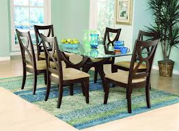 furniture rectangle glass dining table with dark brown wooden base connected by dark brown wooden