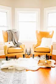 Bay window furniture living Furniture Ideas Pair Of Tan Leather Wingback Chairs Set Back In Bay Window Crate And Barrel How To Style Bay Windows The Crate And Barrel Blog
