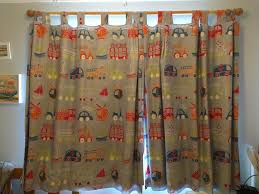 boys blue vehicle pattern tab top curtains with blackout lining sewn in 133cm wide x 138