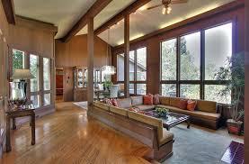 sunken living room with red oak floors