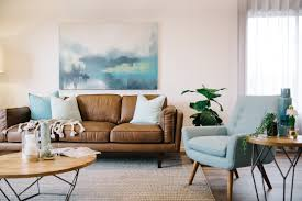 living room colors brown leather furniture. minus the blue chair good reference picture to show how brown leather couches pillows and seascape will look together living room colors furniture