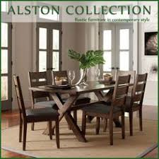 with a rustic and modern look wrapped into one this beautiful dining table and chair set has a knotty and organic appeal of the wood making it perfect for