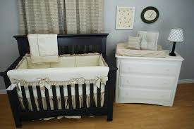 tan crib bedding cream and linen set with arrow fabric shiny accents for a glitzy navy