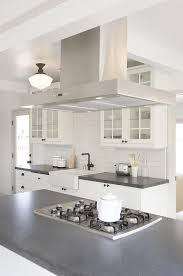 stainless steel vent hood. Black And White Kitchen Features A Stainless Steel Vent Hood Placed Above Center Island Fitted