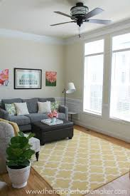 rug on carpet ideas. Yellow Moroccan Rug Brings Some Much Needed Color To A Living Room On Carpet Ideas G