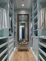 Small transitional gender-neutral medium tone wood floor and brown floor  walk-in closet