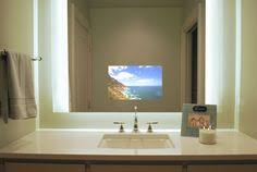low positioned tv mirror in a modern bathroom fixture