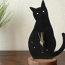 it is wall clock handmade black cat on the cat clock cat clock black cat iron series cat cat accessory interior clock entrance a desk