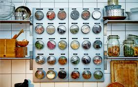 Kitchen with spice storage made of magnetic jars on magnetic boards