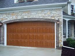 stone house wood wooden garage door luxury glicks glick associates