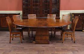 Tropical Round Table- Solid Walnut Expandable Round Dining Table tropical- dining-room
