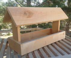 woodworking projects for kids bird house. this bird feeder is made of cedar wood. it measures 18 x 7 10 tall. comes with 2 eyelet hooks on top for easy hanging. woodworking projects kids house o