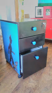 TinTin filing cabinet with colour coordinated draw knobs.