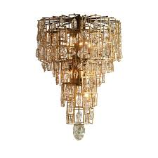 the kara chandelier by jean de merry is handmade glasetal and the crown jewel of chandeliers the metal gives it a rock star vibe and the glass