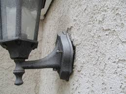 rain will often find its way into a wall if the exterior light fixture is not properly caulked therefore proper caulking will help prevent water from