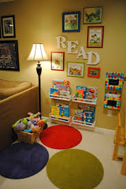 reading nook cute with the framed books love the fact it s in the living room i would love to put an reading area near the kids reading area