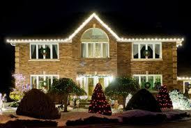 Christmas home lighting Residential Hometips How To Hang Christmas Lights