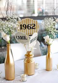 50th anniversary table decorations other decorations included 5 dozen gold silver and white balloons