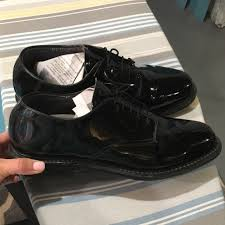 these george boots are made from a black patent leather and are a size 10 these boots are worn by military personnel including deputy lieutenants