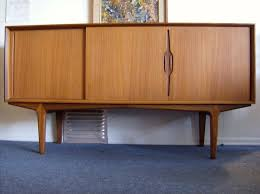minimalist wooden credenza furniture with brown finish and sliding door