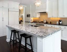 quartz countertops. Chic Kitchen With White Cabinets Featured Under Counter Lights And Quartz Countertops : Attractive