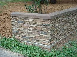 beautiful retaining wall with a facade that mimics the look of real stacked stone