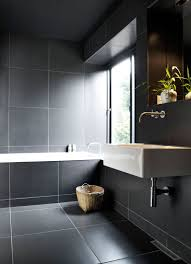 the use of white grout around these large dark tiles works well because the grout doesn t take over the bathroom the tiles are large enough to use such