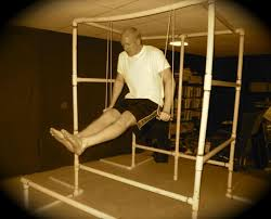 home gym made of pvc pipe doing muscle up