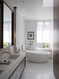 bathroom: Bright Bathroom Interior With Clean White Wall Paint And  Completed With White Freestanding Bathtub