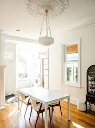 dining room furniture white wood. trendy medium tone wood floor dining room photo in sydney with white walls furniture e