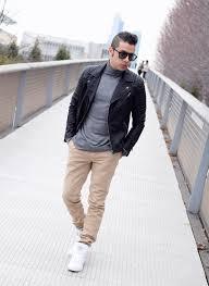 men s black leather biker jacket grey turtleneck khaki chinos white high top sneakers men s fashion