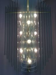 chandelier cleaning vancouver chandelier layered glass elements hanging on metal frame over stairs this is before