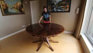 expanding circular dining table in walnut gif find make share gfycat gifs