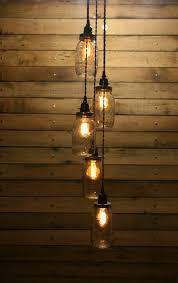 diy 5 jar pendant light mason jar chandelier light kit staggered length hanging mason jar hanging pendant light kit by rewind on