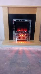 electric fire and maple surround