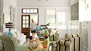 beach style living room furniture. A Family Relaxes In This Beach House Living Room With Striped Arm Chairs, And Style Furniture E