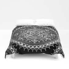 white flower mandala on black duvet