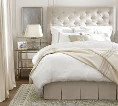 the tufted headboard and mirrored