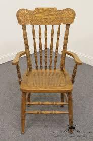 pulaski furniture keepsakes golden oak pressed back arm chair