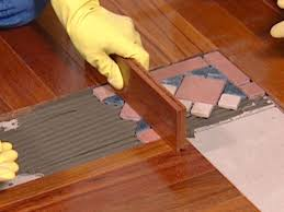 s hardwood used to tap down tile border