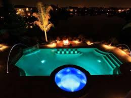 Inground pools at night Outside About Pools Alamy Deck Jets Into Pool At Night Swimmingpoolcom