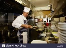 Chef Kitchen Asian Chef Cooking In Restaurant Kitchen Stock Photo Royalty Free