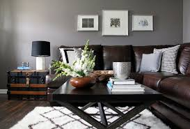 living room with grey walls and brown couch