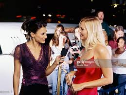side view of a presenter interviewing a star at ceremony award side view of a presenter interviewing a star at ceremony award stock photo