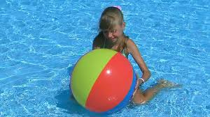 swimming pool beach ball background. Child Girl Playing With Beach Ball In Blue Water. Stock Video Footage - Videoblocks Swimming Pool Background T